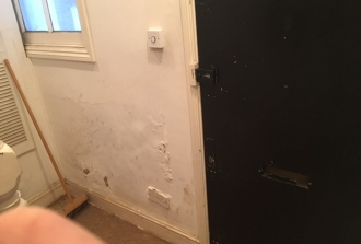 Rising damp affecting internal wall plaster of kitchen area